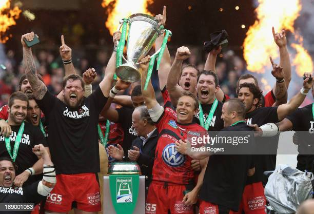 Jonny Wilkinson and Joe van Niekerk of Toulon raise the Heineken Cup after their victory during the Heineken Cup final match between ASM Clermont...