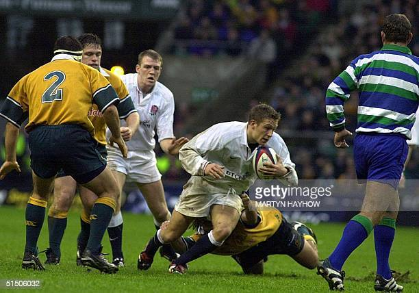 Jonny Wilkinson, England's Stand-off is caught by Australia's flanker George Smith during their match 18 November 2000 at Twickenham.