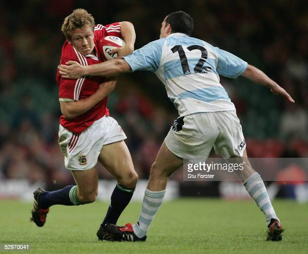 Jonny Wilkinson is tackled by Felipe Contemponi during Match between British and Irish Lions v Argentina at The Millennium Stadium on May 23 2005 in...