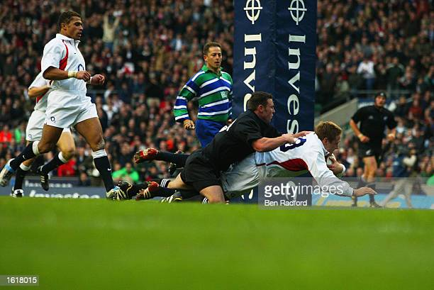 Jonny Wilkinson of England dives over to score a try during the Investec Challenge Match between England and New Zealand at Twickenham London England...