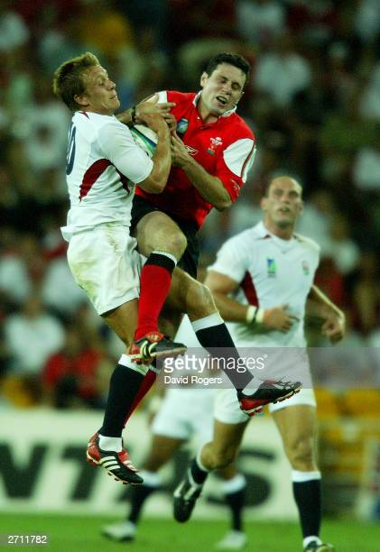 Jonny Wilkinson of England grapples for the ball with Stephen Jones of Wales during the Rugby World Cup Quarter Final match between England and Wales...