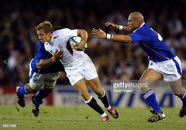 Jonny Wilkinson of England is tackled by Dale Rasmussen and Semo Sititi during the Rugby World Cup Pool C match between England and Samoa at Telstra...