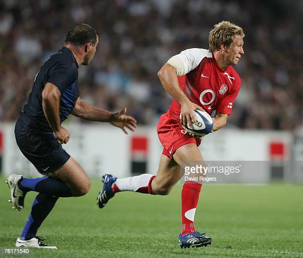 Jonny Wilkinson of England races past Raphael Ibanez during the Rugby Union International match between France and England at Stade Velodrome on...