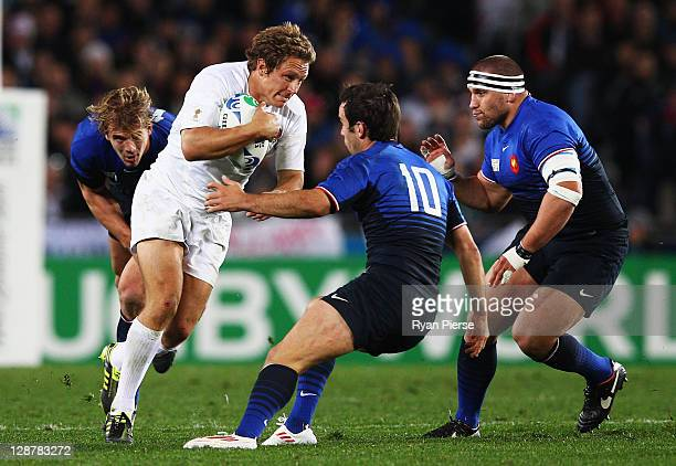 Jonny Wilkinson of England takes on Morgan Parra of France during quarter final two of the 2011 IRB Rugby World Cup between England and France at...