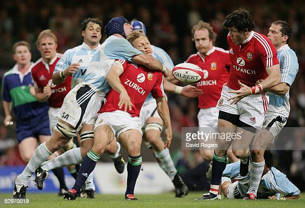 Jonny Wilkinson of the Lions is hit hard as he offloads to team mate Shane Horgan during the Rugby Union International Match between the British and...