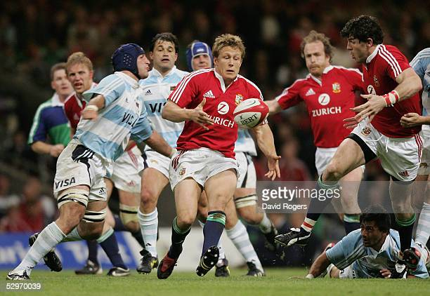 Jonny Wilkinson of the Lions offloads to team mate Shane Horgan during the Rugby Union International Match between the British and Irish Lions and...