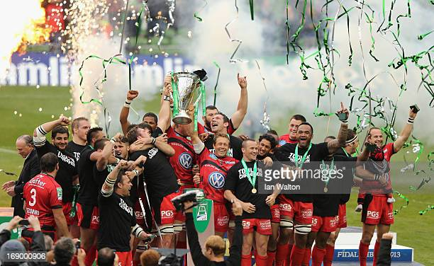 Jonny Wilkinson of Toulon and his teammates celebrate with the trophy at the end of the Heineken Cup final match between Clermont Auvergne and RC...