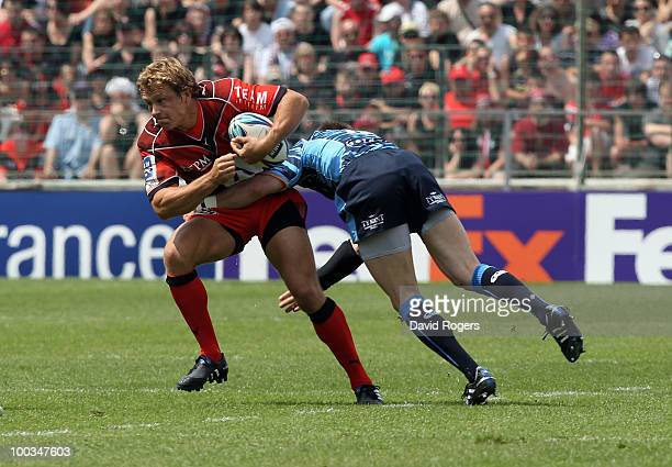 Jonny Wilkinson of Toulon is tackled by Ceri Sweeney during the Amlin Challenge Cup Final between Toulon and Cardiff Blues at Stade Velodrome on May...