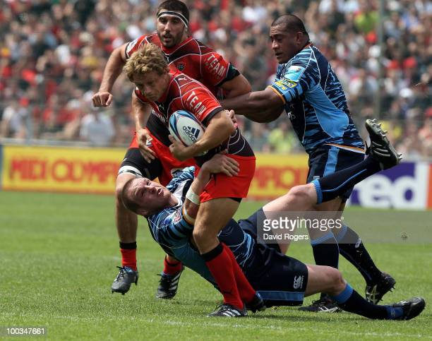 Jonny Wilkinson of Toulon is tackled by Gethin Jenkins during the Amlin Challenge Cup Final between Toulon and Cardiff Blues at Stade Velodrome on...