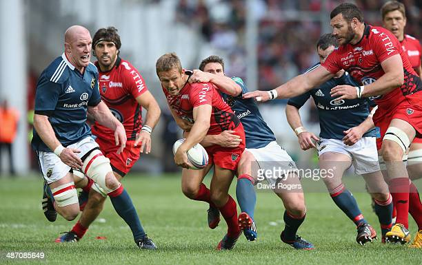 Jonny Wilkinson of Toulon is tackled by Ian Keatley during the Heineken Cup semi final match between Toulon and Munster at the Stade Velodrome on...