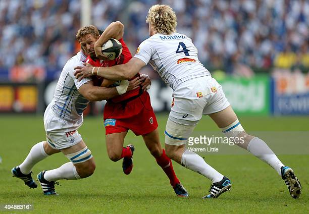 Jonny Wilkinson of Toulon is tackled during the Top 14 Final between Toulon and Castres Olympique at Stade de France on May 31 2014 in Paris France