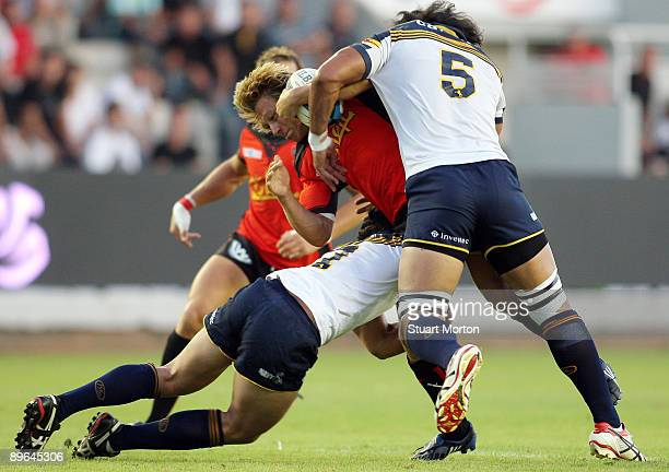 Jonny Wilkinson of Toulon is tackledduring a preseason friendly match between Toulon and the Brumbies at Stade Mayol on August 6 2009 in Toulon France