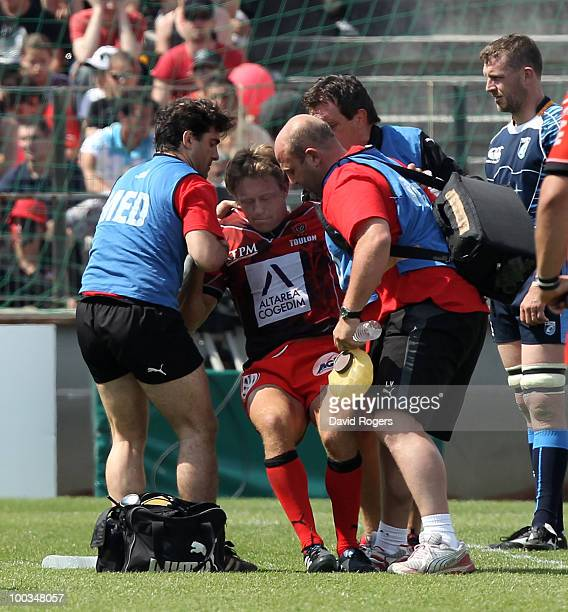 Jonny Wilkinson of Toulon looks in discomfort as he is helped to his feet after being injured during the Amlin Challenge Cup Final between Toulon and...