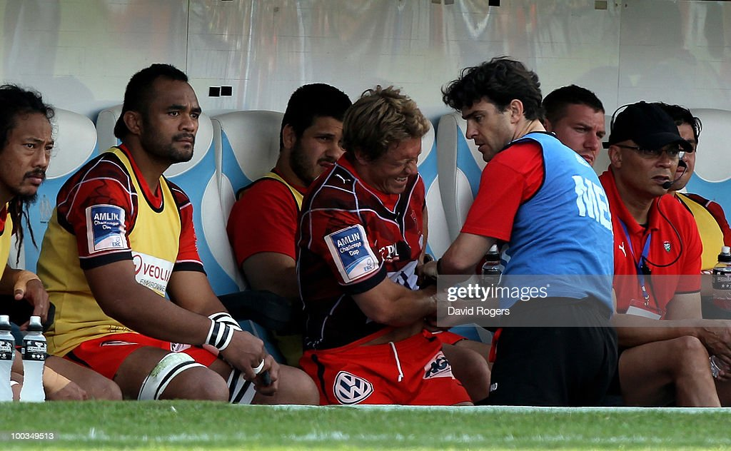 Jonny Wilkinson of Toulon looks in discomfort as he receives treatment to a his back after being replaced during the Amlin Challenge Cup Final between Toulon and Cardiff Blues at Stade Velodrome on May 23, 2010 in Marseille, France.
