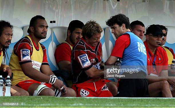 Jonny Wilkinson of Toulon looks in discomfort as he receives treatment to a his back after being replaced during the Amlin Challenge Cup Final...