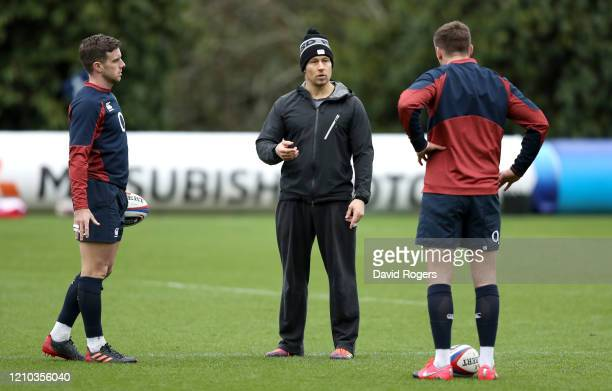 Jonny Wilkinson speaks to George Ford and Owen Farrell of England during a training session ahead of their Guinness Six Nations match against Wales...