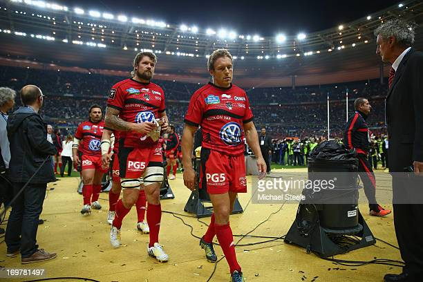 Jonny Wilkinson the captain of Toulon dejectedly leads his side to collect the runners up medals after defeat in the Top 14 Final match between...