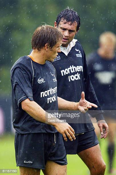 Jonny Wilkinson, the Falcons captain chats with his brother Mark during the Newcaslte Falcons training at Kingston Park on August 10, 2004 in...