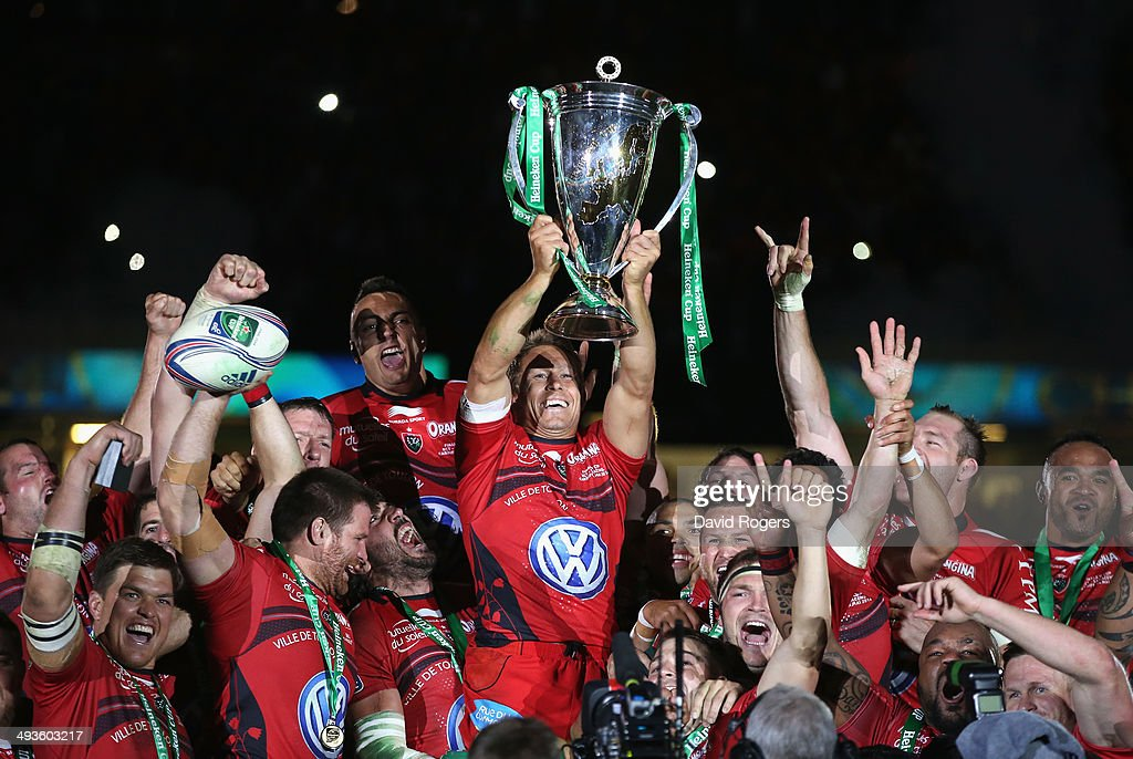 Jonny Wilkinson the Toulon captain, raises the Heineken Cup as his team mates celebrate after their victory during the Heineken Cup Final between Toulon and Saracens at the Millennium Stadium on May 24, 2014 in Cardiff, United Kingdom.