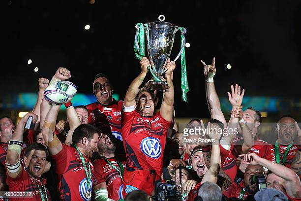 Jonny Wilkinson the Toulon captain raises the Heineken Cup as his team mates celebrate after their victory during the Heineken Cup Final between...