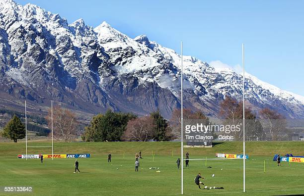 Jonny Wilkinson warms up for kicking practice at the Queenstown Events centre with the stunning backdrop of fresh snowfall on the Remarkables...
