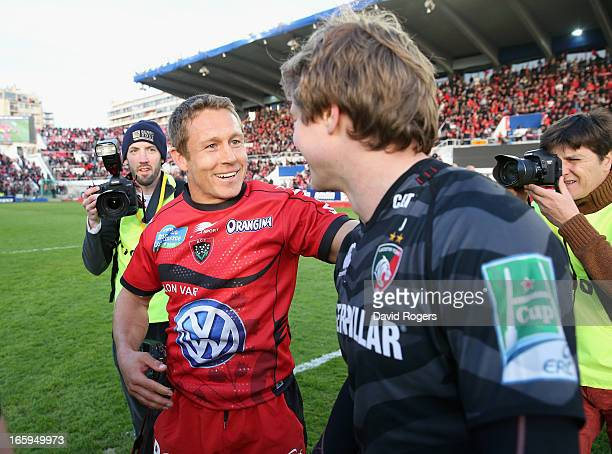 Jonny Wilkinson who kicked all of Toulon's points celebrates with friend and Leicester fullback Mathew Tait after the Heineken Cup quarter final...
