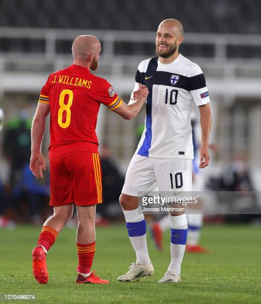 Jonny Williams of Wales and Teemu Pukki of Finland interact during the UEFA Nations League group stage match between Finland and Wales at Helsingin...