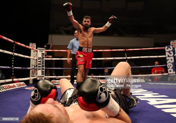 Jono Carroll knocks down Johnny Quigley in the SuperFeatherweight Championship fight at Waterfront Hall Belfast