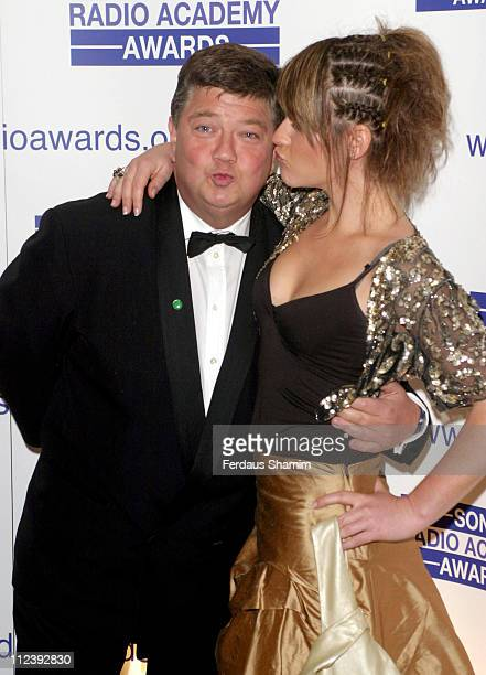 Jono Coleman and Harriet Scott during 2004 Sony Radio Academy Awards Arrivals at Grosvenor House Hotel in London Great Britain
