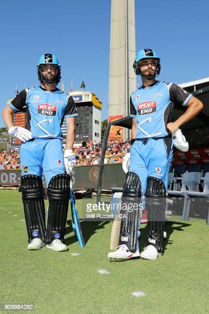 Jono Dean and Jake Weatherald of the Strikers walk out to bat during the Big Bash League match between the Perth Scorchers and the Adelaide Strikers...