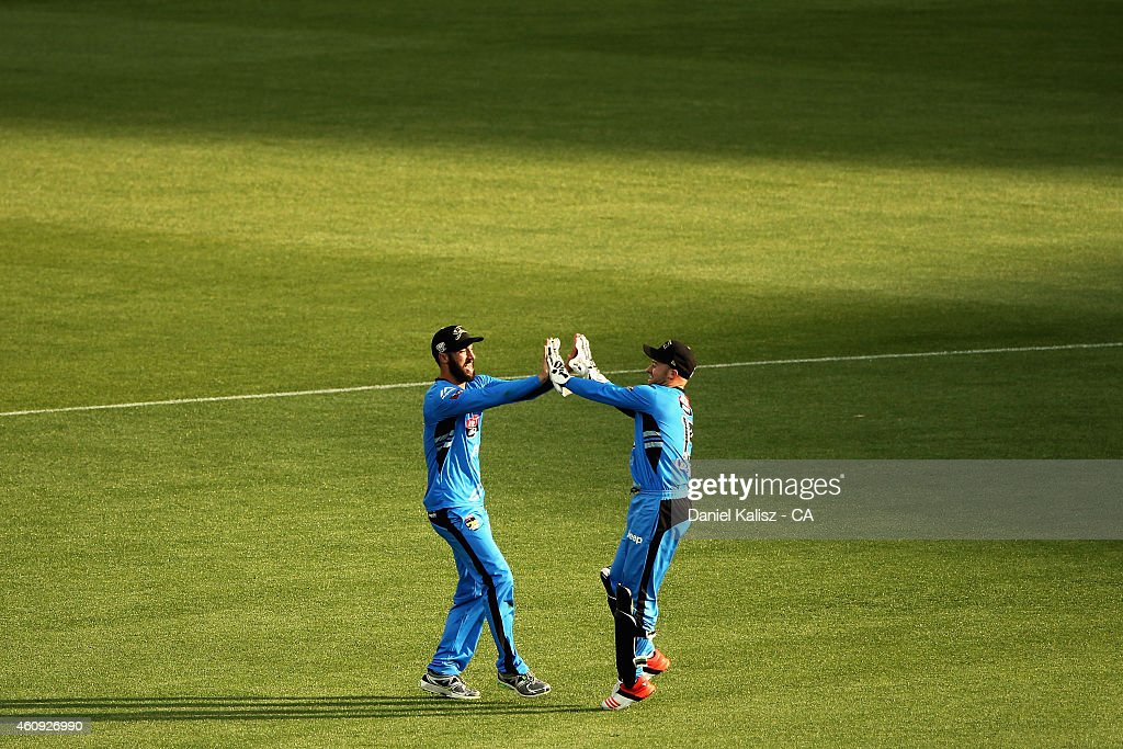 Jono Dean of the Adelaide Strikers celebrates with Tim Ludeman of the Adelaide Strikers after taking a catch during the Big Bash League match between the Adelaide Strikers and the Hobart Hurricanes at Adelaide Oval on December 31, 2014 in Adelaide, Australia.