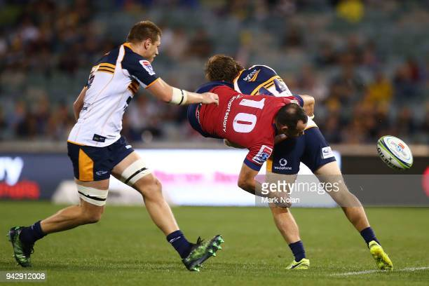 Jono Lance of the Reds is tackled during the round 8 Super Rugby match between the Brumbies and the Reds at University of Canberra Oval on April 7...