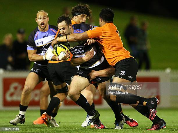 Jono Lance of the Spirit is tackled during the 2016 NRC Grand Final match between the NSW Country Eagles and Perth Spirit at Scully Park on October...