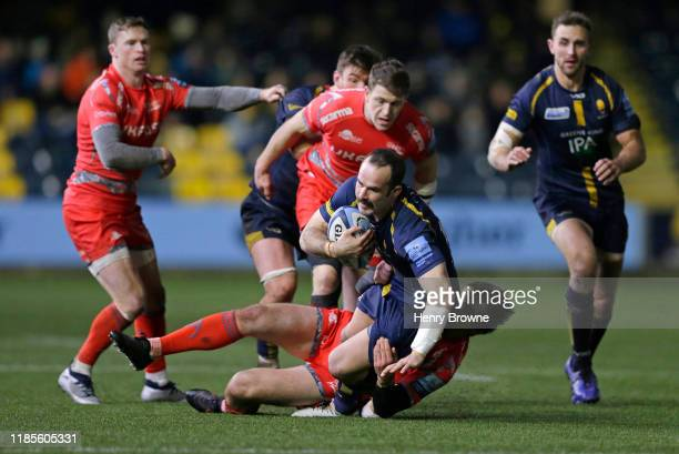 Jono Lance of Worcester Warriors is tackled by AJ MacGinty of Sale Sharks during the Gallagher Premiership Rugby match between Worcester Warriors and...