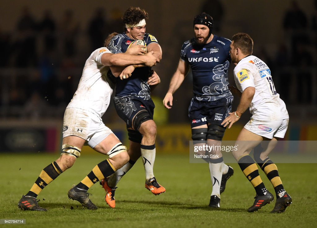 Jono Ross of Sale is tackled by the Wasps defence during the Aviva Premiership match between Sale Sharks and Wasps at AJ Bell Stadium on April 6, 2018 in Salford, England.