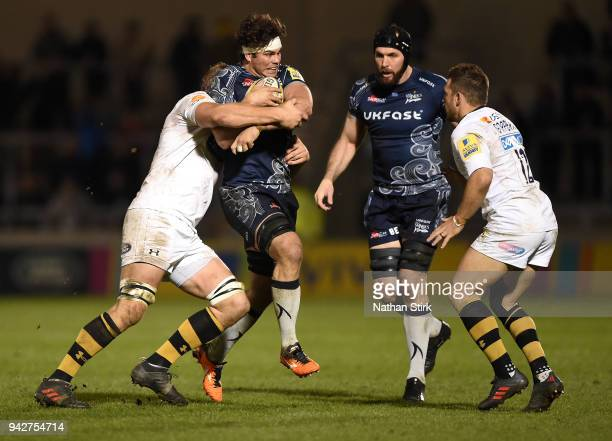 Jono Ross of Sale is tackled by the Wasps defence during the Aviva Premiership match between Sale Sharks and Wasps at AJ Bell Stadium on April 6 2018...