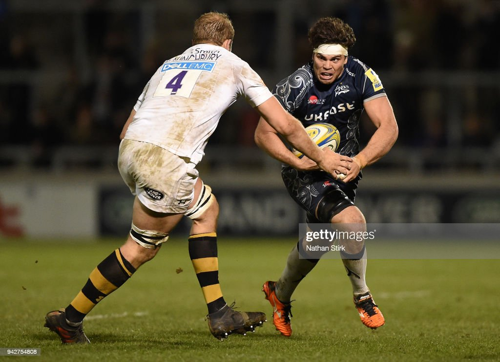 Jono Ross of Sale runs at Joe Launchbury Wasps during the Aviva Premiership match between Sale Sharks and Wasps at AJ Bell Stadium on April 6, 2018 in Salford, England.