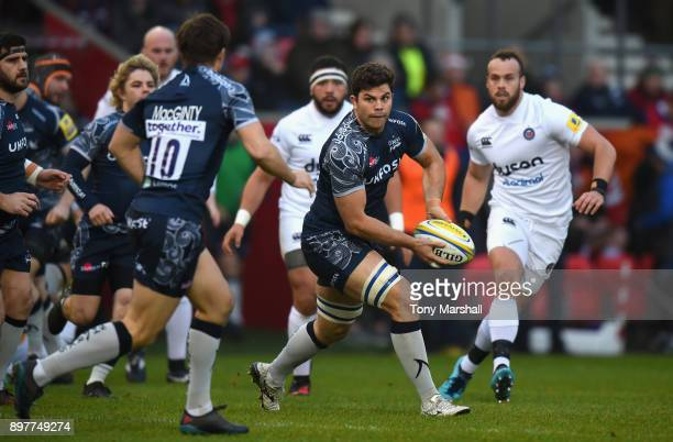Jono Ross of Sale Sharks passes the ball to AJ MacGinty of Sale Sharks during the Aviva Premiership match between Sale Sharks and Bath Rugby at AJ...