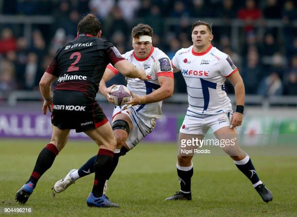Jono Ross of Sale Sharks tackled by Virgile Lacombe of Lyon during the European Rugby Challenge Cup match between Sale Sharks and Lyon at the AJB...