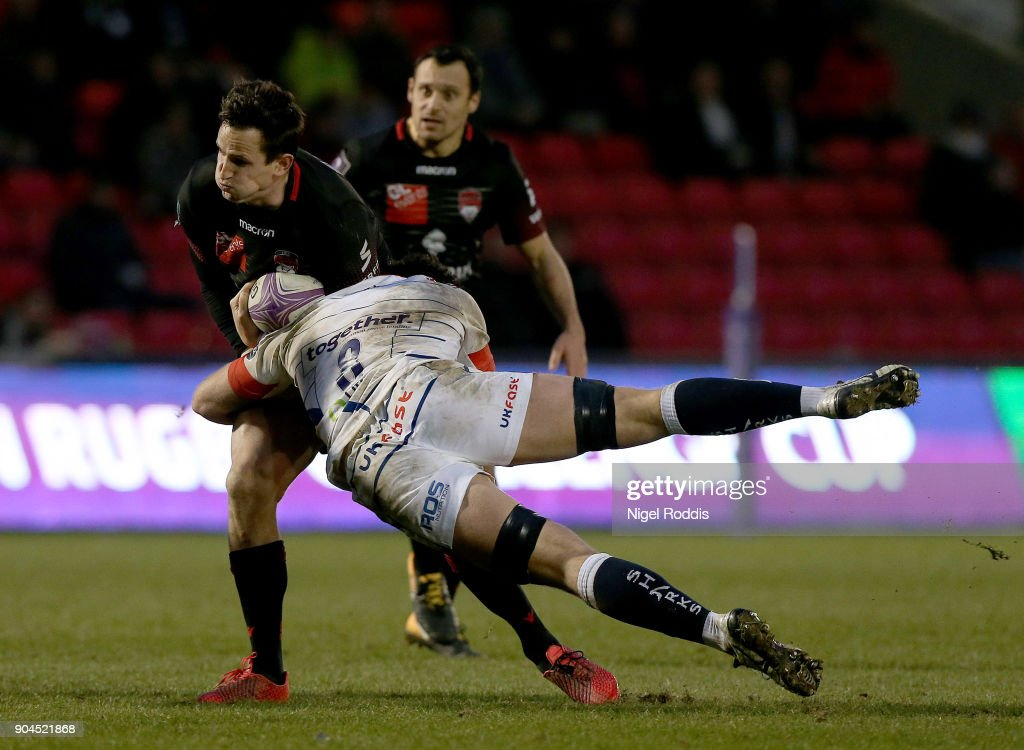 Jono Ross (R) of Sale Sharks tackles Mike Harris of Lyon during the European Rugby Challenge Cup match between Sale Sharks and Lyon at the AJB Stadium on January 13, 2018 in Salford, United Kingdom.