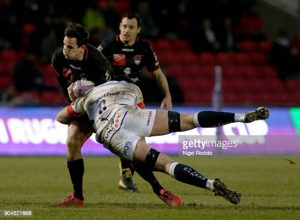 Jono Ross of Sale Sharks tackles Mike Harris of Lyon during the European Rugby Challenge Cup match between Sale Sharks and Lyon at the AJB Stadium on...