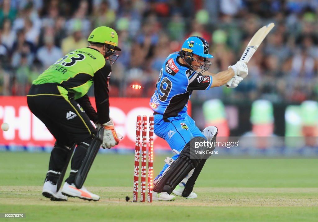 Jono Wells of the Strikers is bowled by Fawad Ahmed of Thunder during the Big Bash League match between the Sydney Thunder and the Adelaide Strikers at Spotless Stadium on January 7, 2018 in Sydney, Australia.