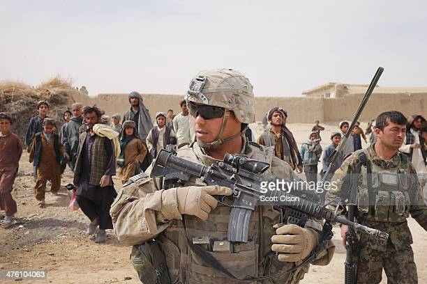 Jonothan Helm from Sikeston Missouri with the US Army's 4th squadron 2d Cavalry Regiment walks through a village during a joint patrol with soldiers...