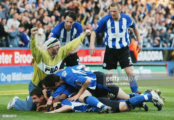 Jon-Paul McGovern of Sheffield Wednesday is mobbed after scoring the opening goal during the Coca-Cola Football League Division One Play-Off,...