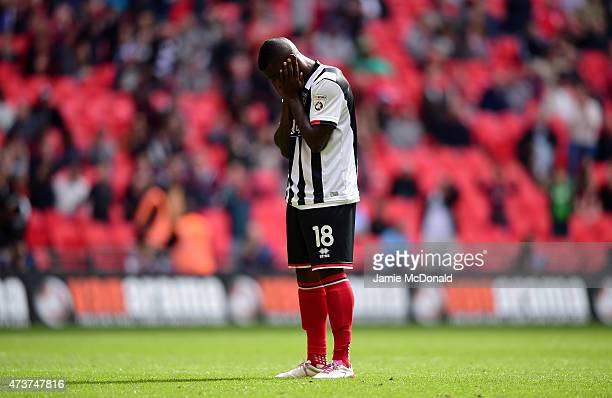 JonPaul Pittman of Grimsby Town stands dejected after missing his penalty during the Vanarama Conference Playoff Final match between Grimsby Town and...