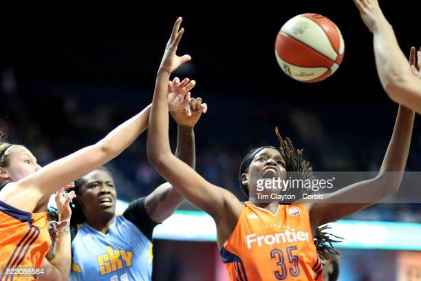 Jonquel Jones of the Connecticut Sun attempts to rebound while challenged by Amber Harris of the Chicago Sky during the Connecticut Sun Vs Chicago...