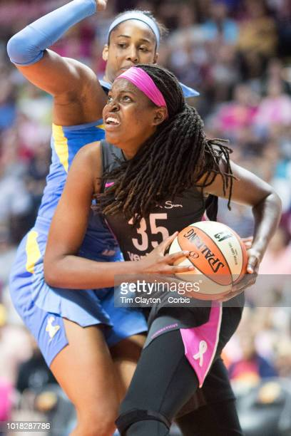 Jonquel Jones of the Connecticut Sun drives to the basket defended by Alaina Coates of the Chicago Sky during the Connecticut Sun Vs Chicago Sky WNBA...