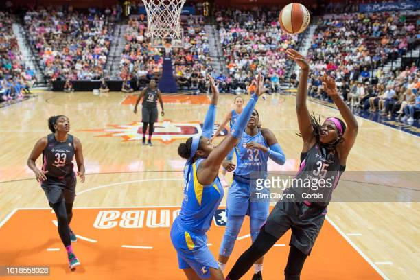 Jonquel Jones of the Connecticut Sun shoots over Alaina Coates of the Chicago Sky during the Connecticut Sun Vs Chicago Sky WNBA regular season game...