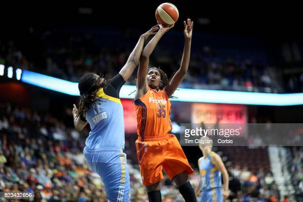 Jonquel Jones of the Connecticut Sun shoots while defended by Amber Harris of the Chicago Sky during the Connecticut Sun Vs Chicago Sky WNBA regular...