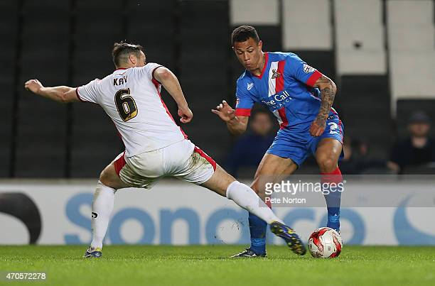 Jonson ClarkeHarris of Doncaster Rovers attempts to move past Antony Kay of MK Dons during the Sky Bet League One match between MK Dons and Doncaster...